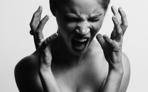 Woman with chronic pain screaming